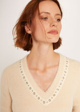 Pull manches longues a details oeillets vanille femme